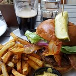 """The real thing"" burger with some bacon and avocado added, fries, and a Guinness."