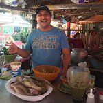 Jorge, owner and chef is showing off his fresh catch to make the absolute best fish tacos  and g