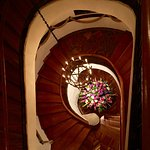 Gorgeous stair case (note beautiful fresh flower arrangement they keep each day at the bottom)
