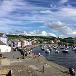 View of Aberaeron harbour with the Harbourmaster in lilac on the left