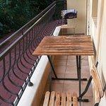 Narrow, shared balcony
