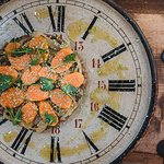 A tartare of fresh local Tuna, flavoured with Wasabi and 'garni' escabeche. The clock on the oth