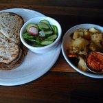 Korean Pork sandwich, cucumber salad & Griddle Potatoes with Romesco.