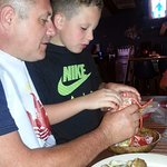 son learning how to eat lobster.