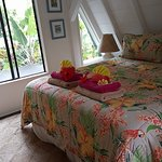 Upstairs bedroom. Very comfortable king bed and bedding. Beautiful flowers all over the cottage.