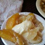 Heavenly warm peach cobbler with vanilla ice cream!