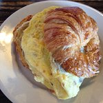 Delicious breakfast and treats. My daughter and I shared an omelette croissant, raspberry danish
