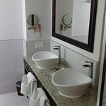 Room 2129 bathroom with dual sinks, large glass-enclosed shower