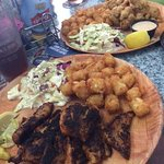 Blackened yellow tail w/tots in front and fried oysters w/tots in back