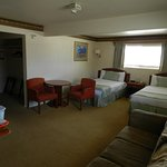 Suite with 2 full beds with a fold out couch & a kitchenette