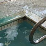 Black oily scum around hot tub and nasty water