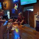 Bartenders Casper and Ashley having fun with customers.