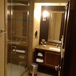 Clean and large, toilet is off to the right in another little room with a closing door. Very nic