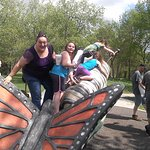Climbing on the butterfly & caterpillar outside the butterfly house