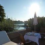 Breakfast on the terrace overlooking the pool