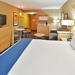 Enjoy our very spacious King Suite w/ sofa and tables
