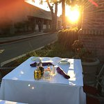 Sunset over outdoor seating area at Fontina Ristorante