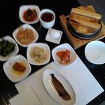 Banchan and rice served with the meal