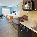 A suite with kitchenette and dining area