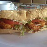 """Shrimp poboy and spicy """"Dat spicy Bloody Mary. Good service. As a local I visit here often"""