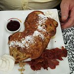 Cinnamon Raisin French toast Fruit compote, maple syrup, real whipped cream with a side of bacon