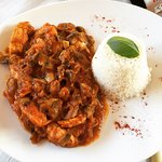 Beautiful dish... Chicken, mushrooms, onions in a tomato, oregano & black pepper sauce with rice