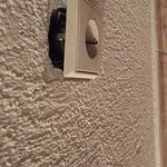 Light switch hanging off the wall