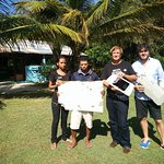 with owner Maurizio and staff holding Malaysia,Airlines 370 debris