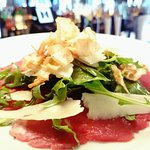 Fillet steak carpaccio served with celeriac crisps and truffle oil