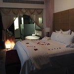 Our room on arrival with a freshly run bubble bath surrounded with rose petals