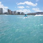 surfing in front of diamondhead