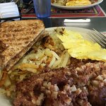 Scrambled eggs, corned beef, hashbrowns, toast -- yum