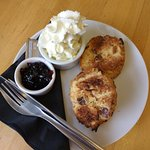 GF scone with whipped cream and blueberry jam