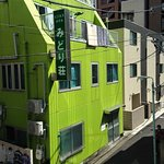 No smoking signs on streets, a nice green building diagonally opposite house ikebukuro and our r