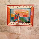 This is the whimsical tile set into the back of the tub/shower.