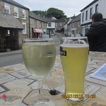 My heaven. Drink sitting outside St. Agnes Hotel looking at the village, Churchtown.