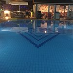 Pool area by day and night
