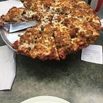 Biggest, densest, meatiest, cheesiest pizza I've ever eaten. Enough said.