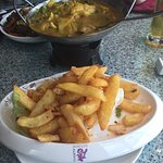 Chicken and mushroom curry with salt and pepper chips