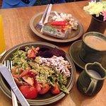 Coffee, salad platter, quiche with salad, orange juice