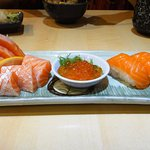 Platter of raw salmon pieces, with large roe