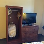 Strange wardrobe / TV cabinet. (Ironing board is behind the bathroom door.)