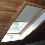Skylight in the sleeping loft, with integrated roller shade