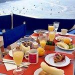 Breakfast on the terrace overlooking the sea