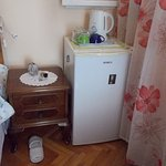 Fridge next to the bed