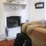 Functional fireplace! Room also has queen bed, chairs and table by large windows