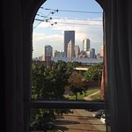 View of Pittsburgh skyline from arched room window