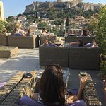 A glass of wine with a view of the Acropolis