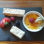 Creme Brulee with fresh fruit garnish and shortbread