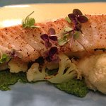 Cod fish with parmesan crusted cauliflower and white wine sauce